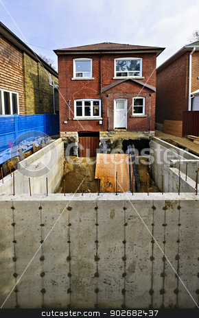 Building addition to home stock photo, Building addition to residential house with new foundation by Elena Elisseeva