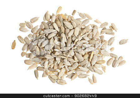 Sunflower seeds on white stock photo, Heap of raw shelled sunflower seeds isolated on white background from above by Elena Elisseeva