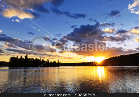 Lake sunset stock photo, Sun setting over tranquil lake and forest in Algonquin Park, Canada by Elena Elisseeva