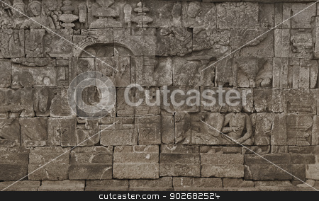 Medieval carving on the walls of the Borobudur temple stock photo, Medieval carving on the walls of the Borobudur temple. Indonesia, Yogyakarta by Alexey Romanov