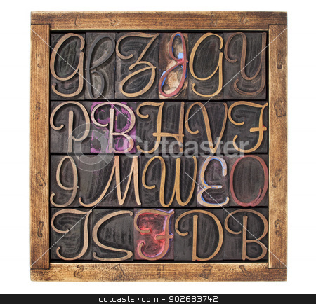 letterpress wood type blocks stock photo, vintage letterpress wood type printing blocks  (script font) stained by color inks in a wooden box by Marek Uliasz