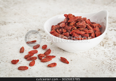 goji berries in bowl stock photo, small ceramic bowl of  dried goji berries against a ceramic tile background with a copy space by Marek Uliasz