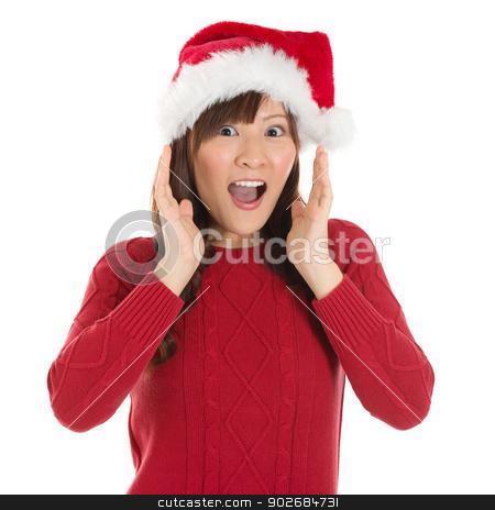 Shocked Asian Santa woman stock photo, Shocked Asian Santa woman shouting isolated over white background. Asian female model. by szefei