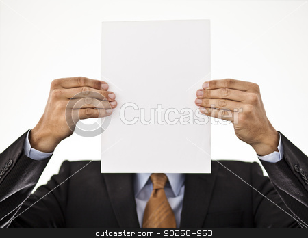 Businessman holding white paper in front of his face stock photo, Businessman holding white paper in front of his face showing a concept by Thomas Rugdal