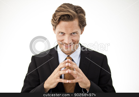 Contemplating Businessman holding fingers together in front stock photo, Businessman holding fingers together in front contemplating by Thomas Rugdal
