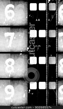 Old Film stock photo, Close up of vintage movie film strips by Janaka Dharmasena
