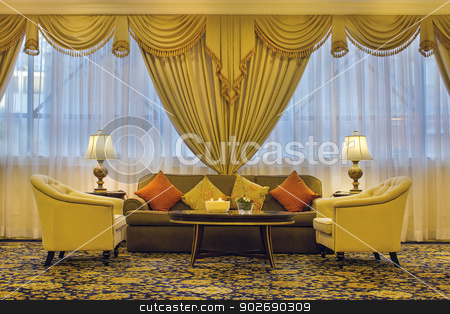 Living Room with Ornate Curtains and Furniture stock photo, Living Room with Ornate Curtains Chairs Couch Side Table Lamps Throw Pillows by Jit Lim