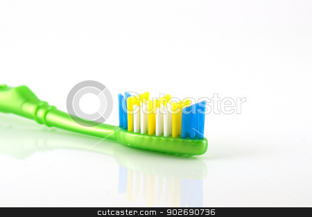 Tooth-brush with green handle stock photo, Tooth-brush with green handle over white. Shallow DOF by Sergei Devyatkin