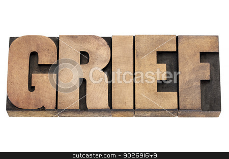 grief word in wood type stock photo, grief word - isolated text in vintage letterpress wood type by Marek Uliasz