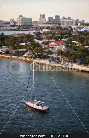 Fort Lauderdale Homes and Skyline with Sailboat stock photo, Fort Lauderdale High End Homes and City Skyline by Scott Griessel