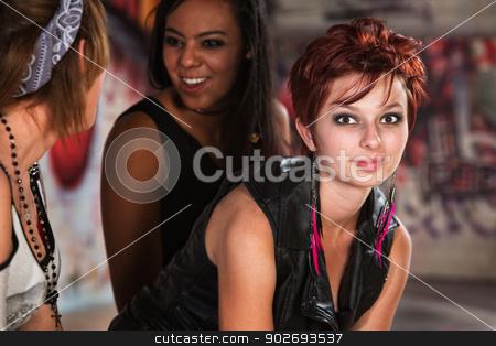 Cheerful Woman with Friends stock photo, Cheerful young woman in sleeveless leather top by Scott Griessel
