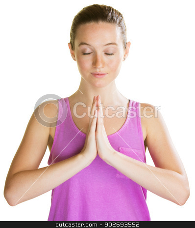 Young Woman Praying stock photo, Athletic young woman with eyes closed praying by Scott Griessel