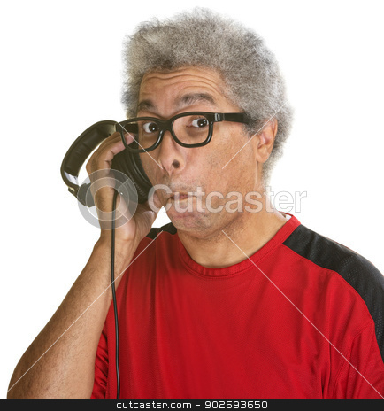 Impressed DJ with Headphones stock photo, Impressed mature African man over isolated background by Scott Griessel