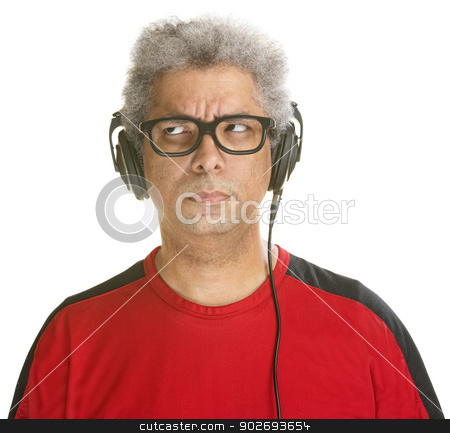 Bothered Mature Man stock photo, Bothered Black DJ with headphones on isolated background by Scott Griessel