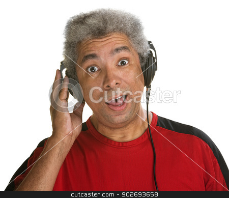 Surprised Man with Headphones stock photo, Excited middle aged man holding pair of headphones by Scott Griessel