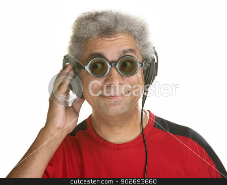 Interested Man with Headphones stock photo, Interested mature male with sunglasses and headphones by Scott Griessel