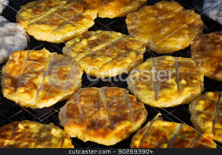 Rice fried cakes. Open market in Thailand stock photo, Rice cakes fried on coals. Open market in Thailand by Alexey Romanov
