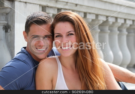 Young Couple Bridge stock photo, Young couple sitting on a bridge. by Henrik Lehnerer