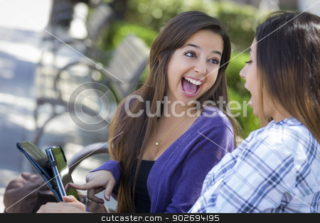 Two Mixed Race Students Using Touch Pad Computer Outside stock photo, Two Happy Mixed Race Students Using Touch Pad Computer Outside Together on Campus. by Andy Dean