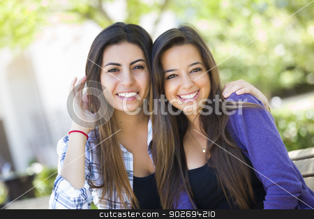 Mixed Race Young Adult Female Friends Portrait stock photo, Happy Mixed Race Young Adult Female Friends Portrait Outside on Bench. by Andy Dean