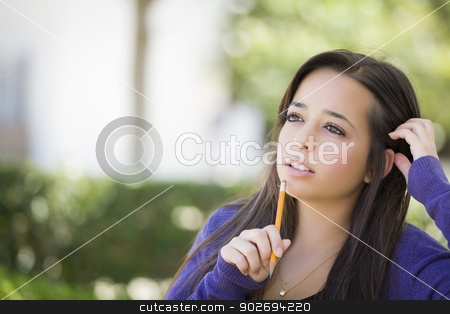 Pensive Mixed Race Female Student with Pencil on Campus stock photo, Attractive Pensive Mixed Race Female Student with Pencil Sitting on Campus Bench. by Andy Dean
