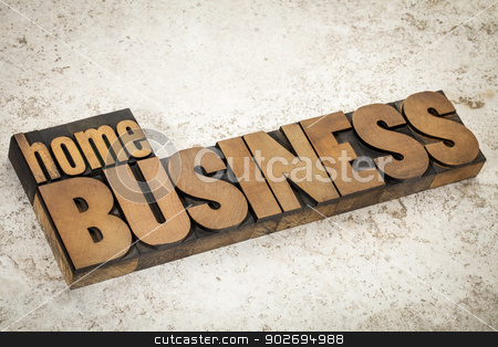 home business  in wood type stock photo, home business text  in vintage letterpress wood type on a ceramic tile background by Marek Uliasz