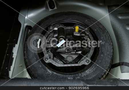 car tire changign set stock photo, car lifter set for tire changing in the back of car by Jozsef Demeter