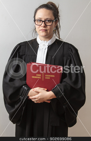 criminal attorney stock photo, woman wearing canadian lawyer toga, holding a bilingual criminal law book, against a white wall by Yann Poirier