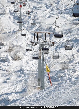 Ski chair stock photo, Sight on a ski lift and space field below it. by Sinisa Botas