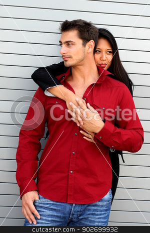 Hugging Couple stock photo, Couple where the girl is hugging him from the back. by Henrik Lehnerer