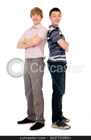 Two cheerful young students standing back to back. stock photo, Two cheerful young students standing back to back. Isolated on white background by Vadim