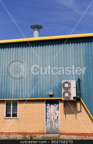 Air conditioning unit on warehouse stock photo, Air conditioing unit on exterior of warehouse building.  by Martin Crowdy
