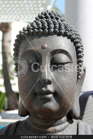 Face of Buddha stock photo, Face of Buddha on statue outdoors. by Martin Crowdy