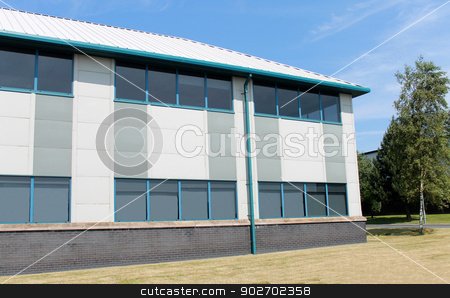 Modern office building stock photo, Exerior of modern commercial office building on business park. by Martin Crowdy