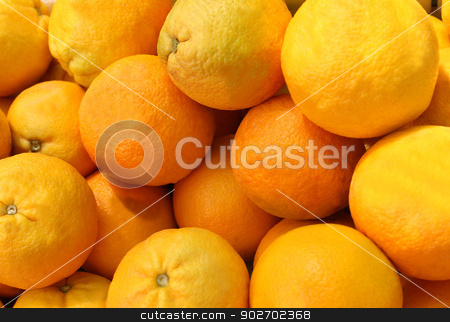 Ripe oranges stock photo, Background of ripe oranges in pile or heap. by Martin Crowdy