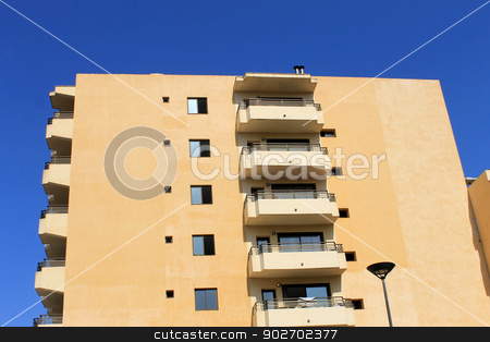 Spanish hotel building stock photo, Side view of modern Spanish hotel building with blue sky background. by Martin Crowdy
