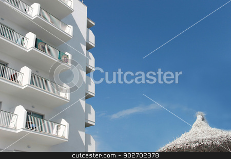 Spanish tourist hotel 1 stock photo, White Spanish tourist hotel with parasol, Majorca, Spain. by Martin Crowdy