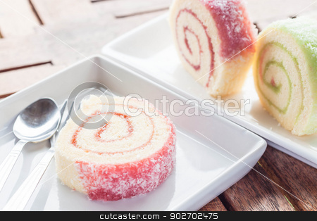 Set of colorful jam rolls with spoon and fork stock photo, Set of colorful jam rolls with spoon and fork, stock photo by nalinratphi