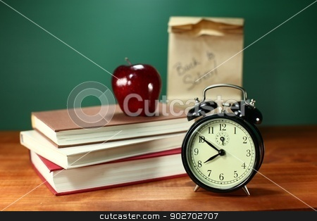 Back to School Items stock photo, Clock Apple and Stack of Books on A Desk for Back to School by Katrina Brown
