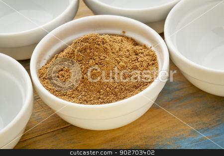 camu fruit powder  stock photo, raw organic dried camu camu fruit powder (Myciara Dubia) in a small ceramic bowl - rainforest superfruit from Peru rich in vitamin C by Marek Uliasz