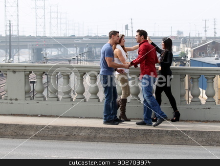Friends Greeting  stock photo, Four friends meeting and greeting each other. by Henrik Lehnerer