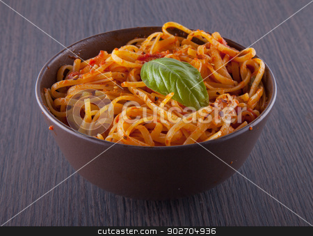 Pasta stock photo, A nest of linguine with sauce in a brown cup by Fabio Alcini