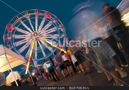 Amusement Park stock photo, People waiting in line at the amusement park to get on the rides by Vlad Podkhlebnik
