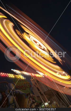 Amusement Park stock photo, blurs and color effects created by rides at the amusement park  by Vlad Podkhlebnik