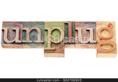 unplug word in wood type stock photo, unplug  - lifestyle or information overload concept  - isolated text in letterpress woodtype by Marek Uliasz