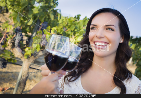 Young Woman Enjoying Glass of Wine in Vineyard With Friends stock photo, Pretty Mixed Race Young Adult Woman Enjoying A Glass of Wine in the Vineyard with Friends. by Andy Dean