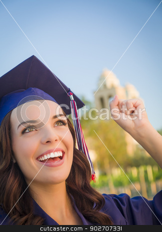 Happy Graduating Mixed Race Woman In Cap and Gown stock photo, Happy Graduating Mixed Race Woman In Cap and Gown Celebrating on Campus. by Andy Dean