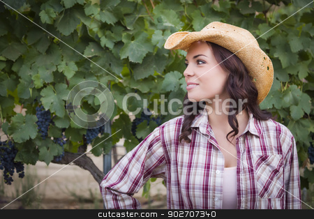 Young Adult Female Portrait Wearing Cowboy Hat in Vineyard stock photo, Young Mixed Race Adult Female Portrait Outside Wearing Cowboy Hat in Vineyard. by Andy Dean