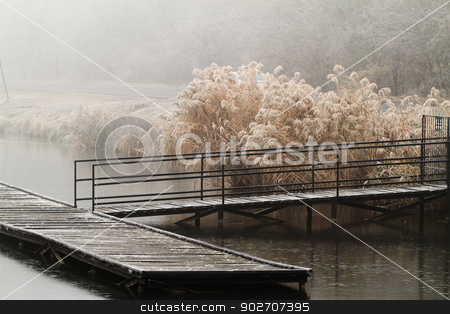 Wooden dock in a lake stock photo, Wooden dock in a lake. Photo taken in a misty day by Nneirda
