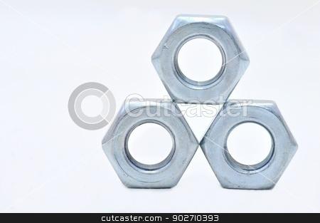 Steel nuts stock photo, Three galvanized steel nuts on a white background by Ondrej Vladyka
